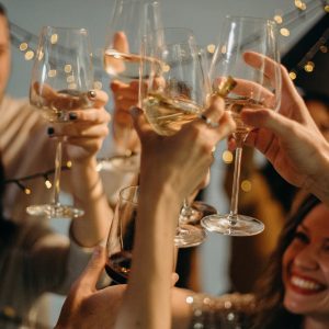 selective-focus-photography-of-several-people-cheering-wine-3171815